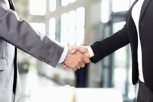 Business people handshake at office.